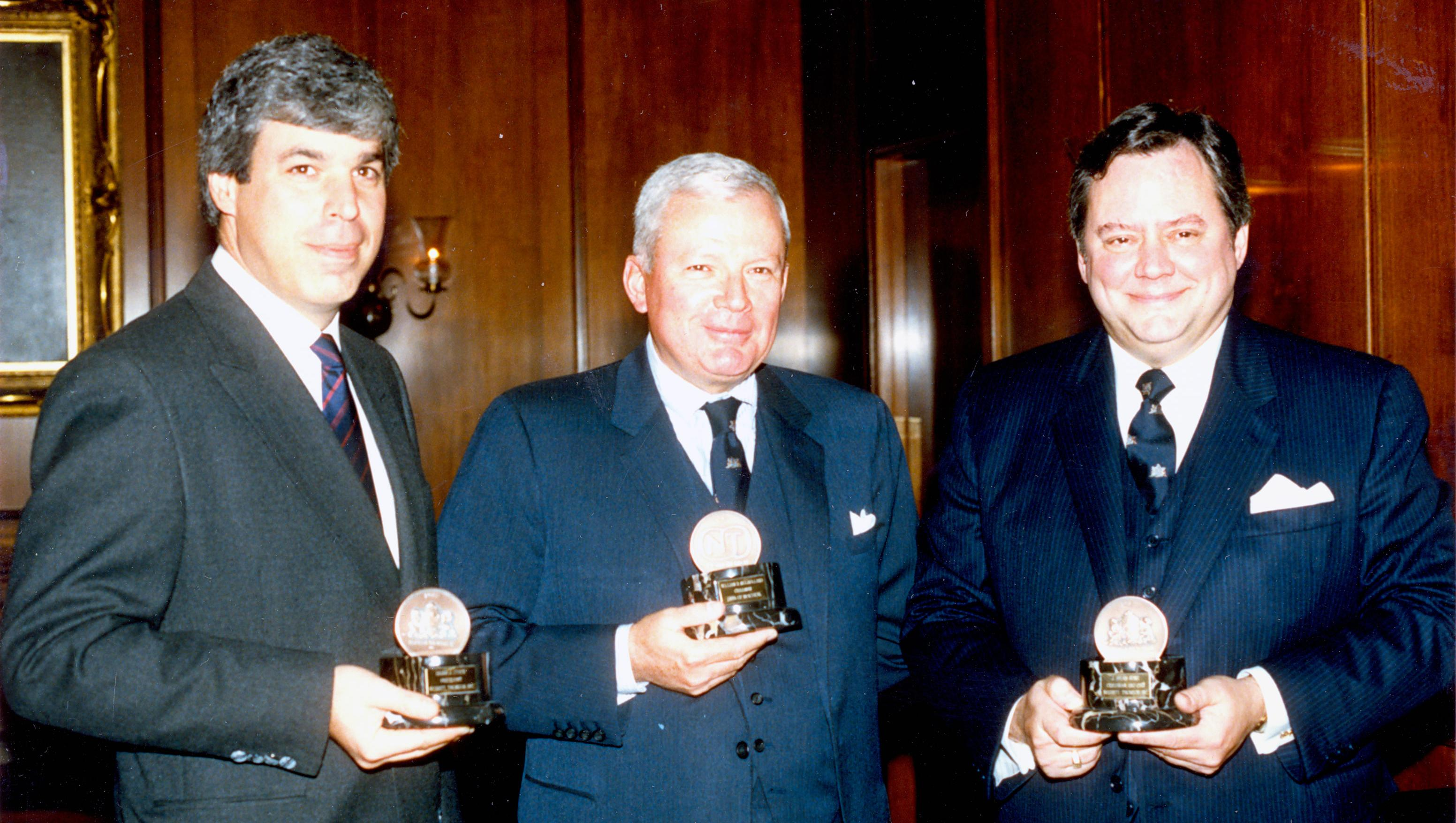Brian Steck, President of Nebitt Thomson,  W.D. Mulholland, Chairman and CEO, Bank of Montreal, and J. Brian Aune, Chairman, Nesbitt Thomson, in October 1987 for the BMO Nesbitt Thomson merger.
